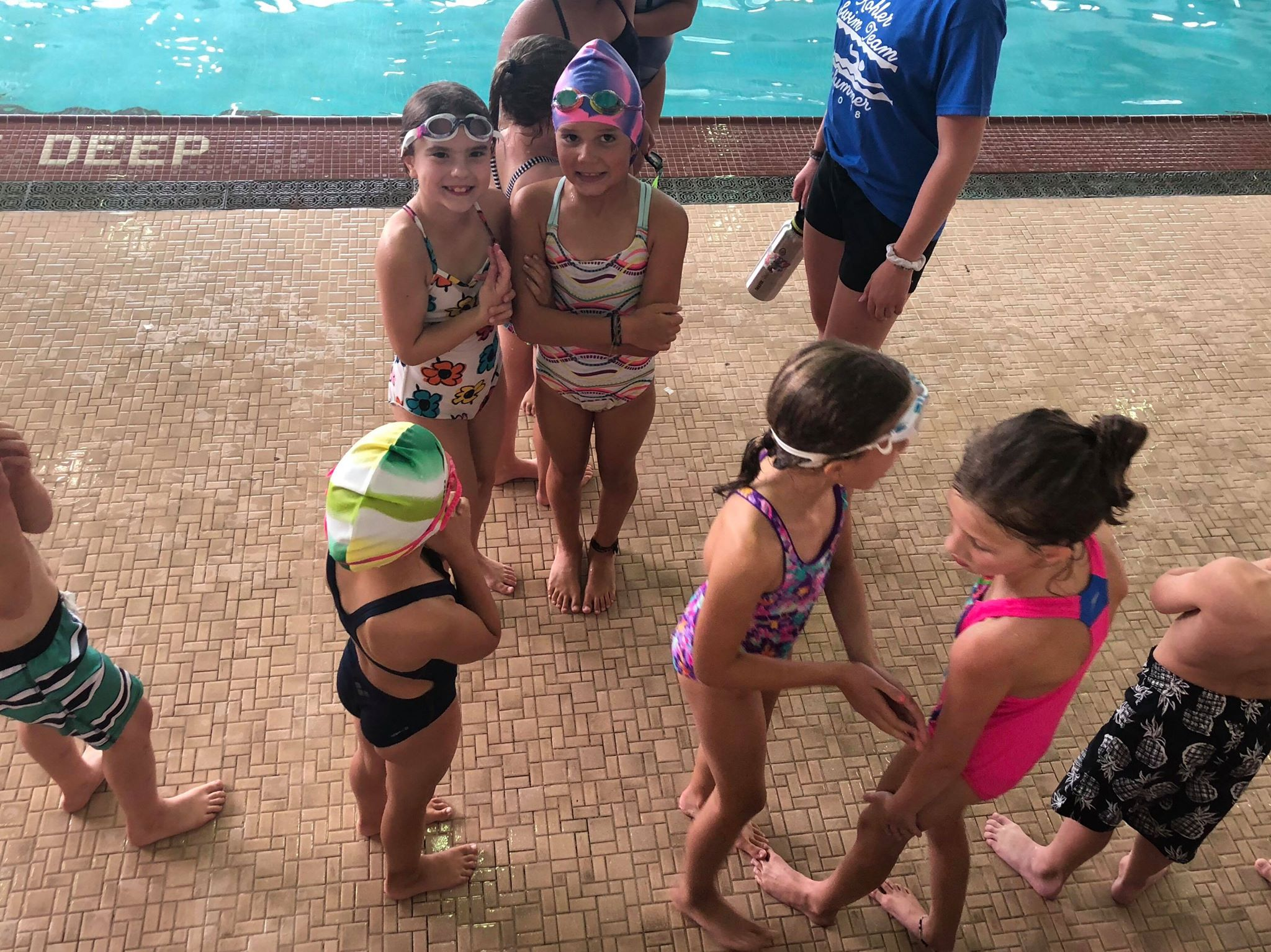 Kids in colorful swim suits at the Kohler Pool